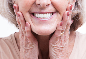 Senior woman smiling with her new same-day dentures from Tim Perry, DDS